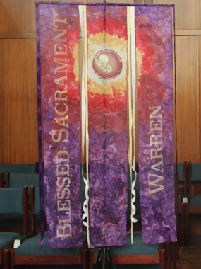 Similar banner for Blessed Sacrament church.  Their deanery had purple.
